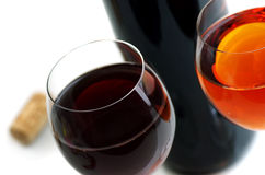 Wine. Bottle and glass of wine on a light background Royalty Free Stock Photo