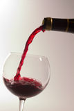 Wine. Red wine being poured from a bottle to a glass