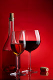 Wine. The big glass of wine and bottle on a red background Royalty Free Stock Photography