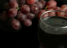 Wine. And grapes over a black background Royalty Free Stock Image