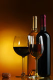 Wine. Bottle and glass of wine on a yellow background Stock Photography