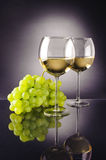 Wine. Glasses and grapes on atmospheric background royalty free stock image