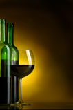 Wine. Bottle, glass of wine on a dark background Royalty Free Stock Image