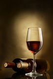 Wine. Bottle and glass of wine on a dark background Stock Photography