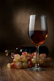 Wine. Bottles of wine and cluster of grapes Royalty Free Stock Image