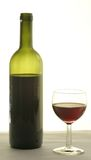 Wine. A bottle of wine and aglass of red wine Stock Images