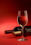 Wine. Glass of white wine on a red background Stock Photos