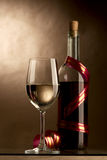 Wine. Bottle and glass of wine on a dark background Royalty Free Stock Photos