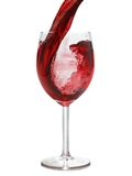 Wine. Red wine pour into glass isolated over white background royalty free stock photo