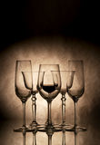 Wine. In glasses on a dark background Royalty Free Stock Photo