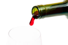 Wine. Red wine pouring down from a wine bottle Royalty Free Stock Photos