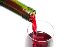 Wine. Red wine pouring down from a wine bottle Royalty Free Stock Photography