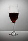 Wine. Glass of red wine on grey background Royalty Free Stock Photos