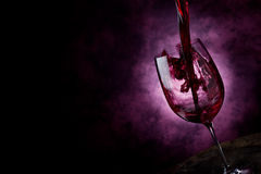 Wine. Photo of Red Wine inside a wine glass with abstract background Royalty Free Stock Photo