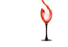 Wine. Red wine pouring into wine glass, isolated on white Royalty Free Stock Image