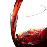 Wine. Pouring red wine into wine glass Stock Images