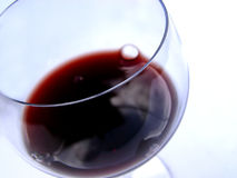 Wine#2. Closeup of red wine and glass focus on the rim royalty free stock images