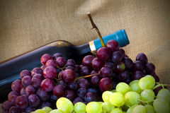 Wine. Composition in table grapes and wine of the harvest Royalty Free Stock Image