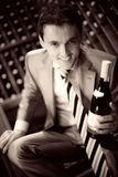 Wine. Closeup of handsome male holding glass of red wine Royalty Free Stock Photography