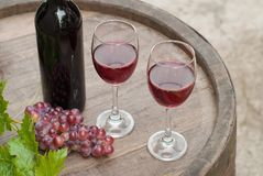 Wine. Glasses of wine on a wine barrel royalty free stock image