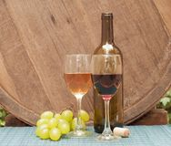 Wine. Glasses of wine on a wine barrel Stock Image