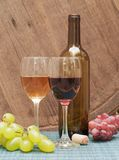Wine. Glasses of wine on a wine barrel royalty free stock images