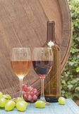 Wine. Glasses of wine on a wine barrel royalty free stock photos