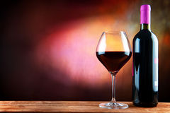 Wine. And bottle on a table Royalty Free Stock Image