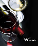 Wine. Glass of red and white wine on black background Royalty Free Stock Image