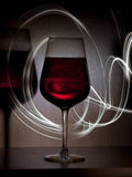 Wine. Glass of wine with light painting in the dark Stock Photo