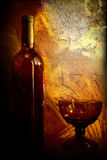 Wine. Bottle wine and glass and red background Stock Photography