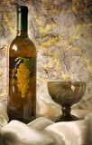 Wine. And glass,bottle and glass on grunge background Stock Photo