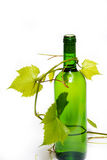Wine. Bottle of white wine with grape foliage like decoration stock photography