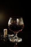 Wine. Still-life with glass of wine over black background stock photography