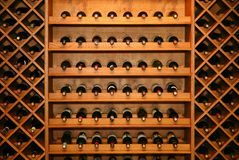 Wine. Luxury home wine cellar. Bottles of wine stacked end on in a large wine rack in a winery. horizontally, diagonal Wine Rack. The image of a rack with Stock Photography