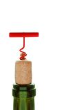 Wine. Bottle with red cork-screw royalty free stock photo