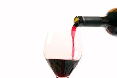 Wine. Red wine with a bottle on a withe background Stock Photo