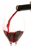 Wine. Red wine with a bottle on a withe background Royalty Free Stock Photo