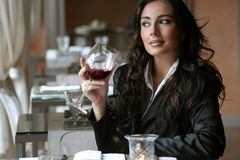 Wine 5. A woman in a restaurant Stock Image