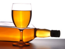 Wine. Champagne in a wine bottle and glass on isolated background with clipping path Royalty Free Stock Photo