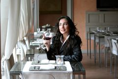 Wine 589. A beautiful woman in a restaurant Royalty Free Stock Photography