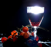 Wine. A glass of red wine and grapes Stock Image