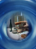Wine. Hand holding wine glass - abstract background Royalty Free Stock Image