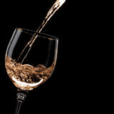 Wine. Cold wine pouring into the glass Stock Images