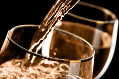 Wine. Pouring into the glass Stock Images