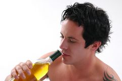 Wine. A shirtless man drinking wine royalty free stock photos