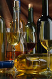 Wine. Bottles and glasses of excellent wine on a dark background Royalty Free Stock Photos