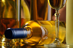 Wine. Bottles and glasses of excellent wine on a dark background Stock Images