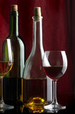 Wine. Bottles and glasses of excellent wine on a dark background Stock Photos