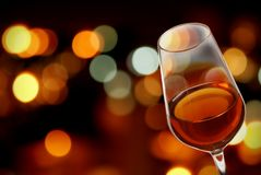 Wine. Glass of wine with a background of city lights Royalty Free Stock Photos